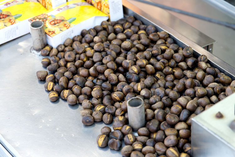 High angle view of roasted chestnuts for sale at market