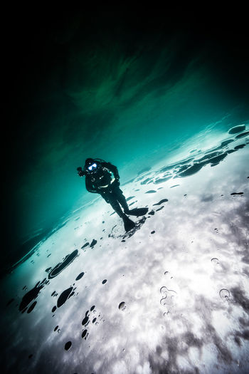 winter underwater Adventure Beauty In Nature Blue Cloud Cloud - Sky Cloudy Day Enjoyment Fun Leisure Activity Lifestyles Low Angle View Mid-air Nature Outdoors Skill  Sky Tranquility Unrecognizable Person Weather