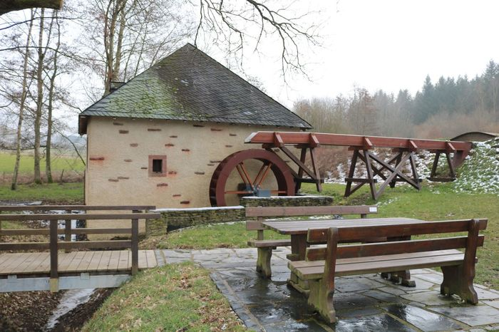 Alte Mühle Vonfrüher Alt Old Oldmill Mill Mühlen Mühle Niedermennig Architecture Plant Built Structure Tree Water Nature Seat Wood - Material Building Exterior No People Building Bench Water Wheel Day Landscape Fence Table Sky Outdoors Rain