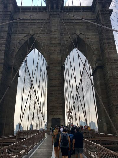 Bridge - Man Made Structure Connection Engineering Suspension Bridge Transportation Built Structure Architecture Brooklyn Bridge / New York Travel Destinations Tourism Journey Women Men Sky Day Large Group Of People People Outdoors City Adult