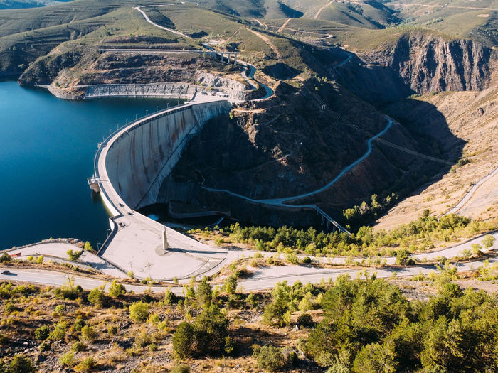 Aerial view of the atazar reservoir and dam in the mountain range of madrid