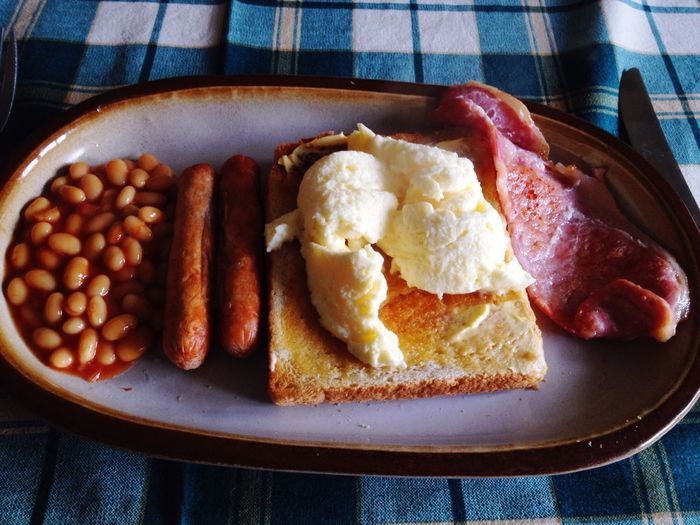 Close-up of english breakfast served on table