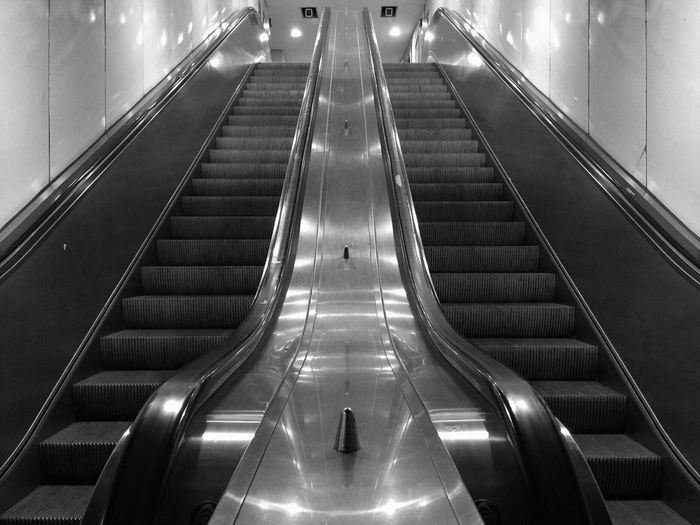 Indoors  Modern Built Structure Illuminated Futuristic The Way Forward Steps And Staircases No People Moving Walkway  Architecture Light Symmetry Perspective Hamburg Iphone6 Monochrome Black And White Escalator