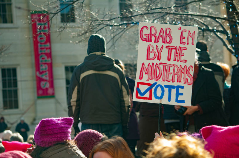A large crowd gathers for the Women's March in Dayton, Ohio showing their support and their homemade signs. Crowds Dayton, OH Love Protest Sign Signs Built Structure Colorful Communication Crowd Crowd Of People Day Large Group Of People March Outdoors People Protest Protestor Real People Rear View Red Text Trump Women Women's March