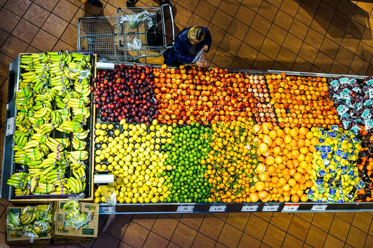 grocery shopping in the city Shopper Fruits Shopping Market Choice Consumerism Retail  Variation Price Tag Multi Colored Vegetable For Sale High Angle View Display Shop Collection Various Retail Display Arrangement