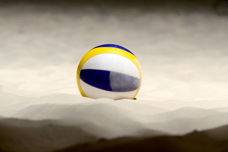 Volleyball on sand at beach
