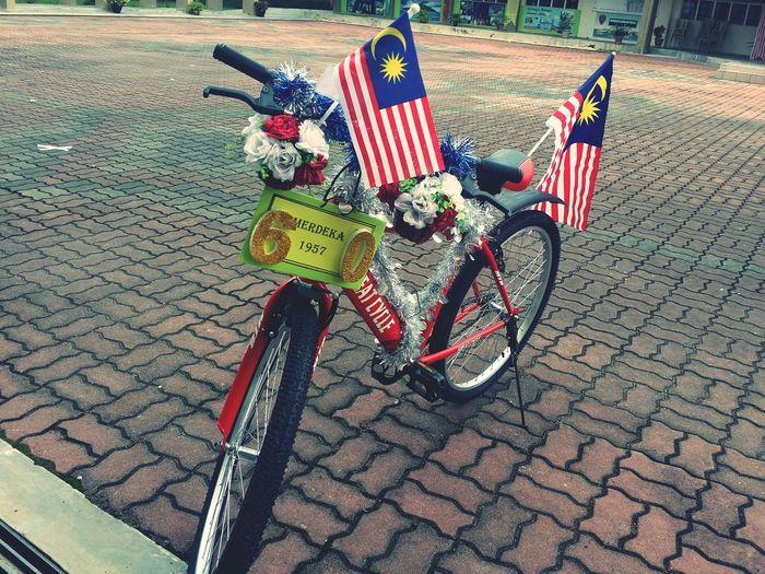 EyeEm Selects Merdeka Day Celebration Merdeka Bicycle Patriotism No People Outdoors Day Flag Stars And Stripes Flat