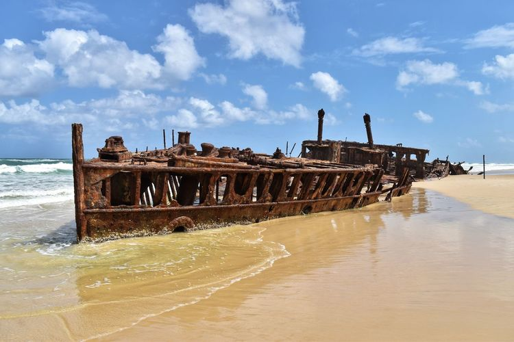 Water Sky Sea Cloud - Sky Beach Shipwreck Nature Nautical Vessel Land Abandoned Day Ship Damaged Decline Transportation Obsolete Motion Deterioration Horizon Over Water No People Outdoors