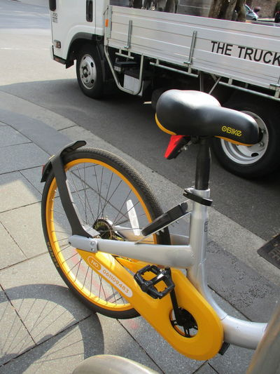 We like to label? Labels Text Traffic Bicycle Bicycle Hire Bicycle Rack Bike City Close-up Cycling Day Environment Handlebar Label Land Vehicle Mode Of Transport No People Outdoors Parking Road Stationary Street Transportation Truck Yellow Paint The Town Yellow