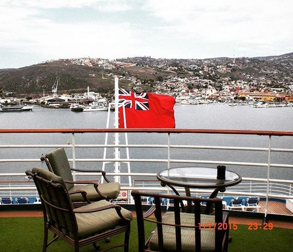 Nothing but the sound of the flag and smell of the sea as I relaxed...peaceful morning. (January winter break cruise photos) Cruise Cruiseship Morning Mornings Flag Table Clouds Ocean Sky Boat Mountains Travel Traveler Traveling Theworldguru