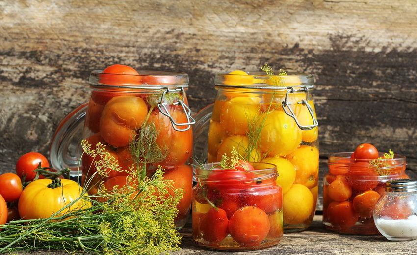Fruits in glass jar on table