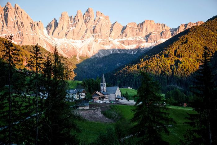 Glow of the Dolomites Dolomites, Italy Mountain Plant Tree Architecture Beauty In Nature Nature Sky Building Exterior Scenics - Nature Built Structure Mountain Range Building No People History Tranquility Environment Growth Tranquil Scene The Past Landscape