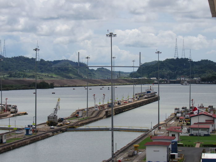 High angle view of harbor by river against sky