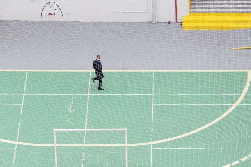 High angle view of man on sports court