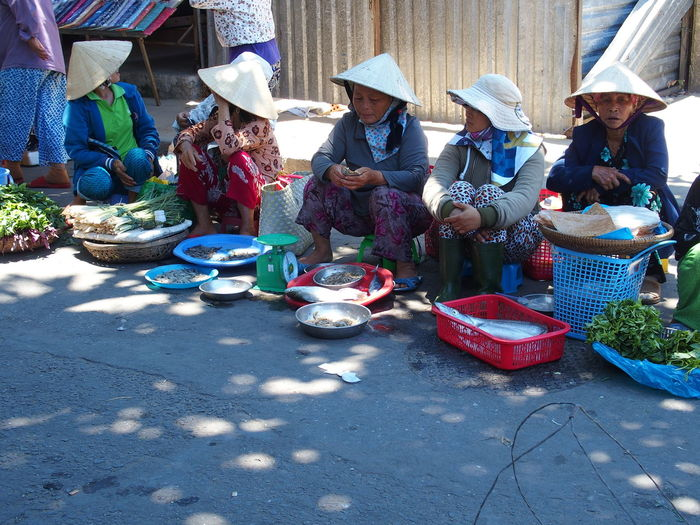 Trip in Hoi An, Vietnam August 2015. Chinese Hat Fish Food For Sale Hoi An Hoi An, Vietnam In A Row Market Market Market Stall Sale Shadow Side By Side Sitting Small Business Street Tourism Vegetable Vietnam Woman