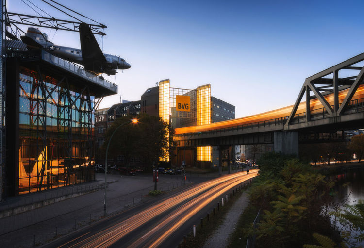 Architecture Bridge Bridge - Man Made Structure Building Exterior Built Structure City Clear Sky Connection Dusk Illuminated Mode Of Transportation Motion Nature No People Office Building Exterior Outdoors Plant Rail Transportation Road Sky Transportation