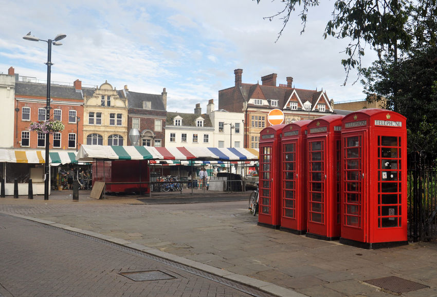 red telephone booths in Cambridge Architecture Booth Cambridge City Color Day England Market Stall Outdoors Red Sky Square Street Streetphotography Telephone Telephone Booth Travel Travel Destinations Typical