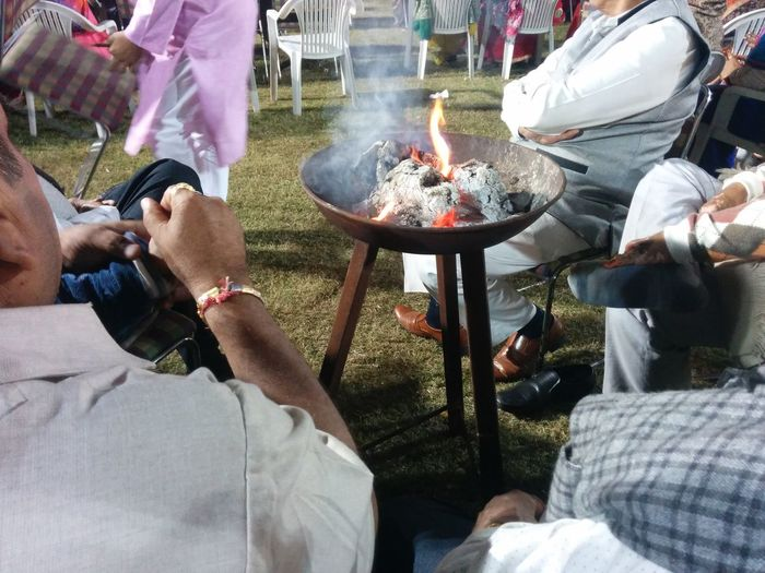 Men Celebration High Angle View Women People Adult Food And Drink Adults Only Food Togetherness Day Real People Party - Social Event Low Section Outdoors Water Only Men Social Gathering Bride Bridegroom Man Sitting Near Fire