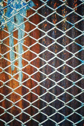 Full frame shot of metal grate on wall