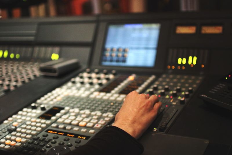 Cropped image of person using sound mixer