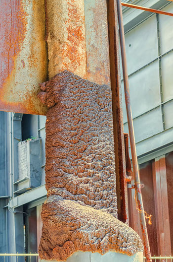 Molten iron, metal solidifies on a iron pillar Architecture Brown Building Building Exterior Built Structure Close-up Day Food Food And Drink House Industry Large Group Of Objects Low Angle View Metal No People Outdoors Rusty Stack Wall - Building Feature Window