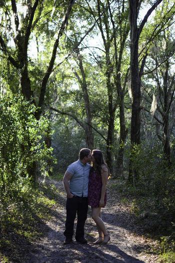 Rear view of two women walking in forest