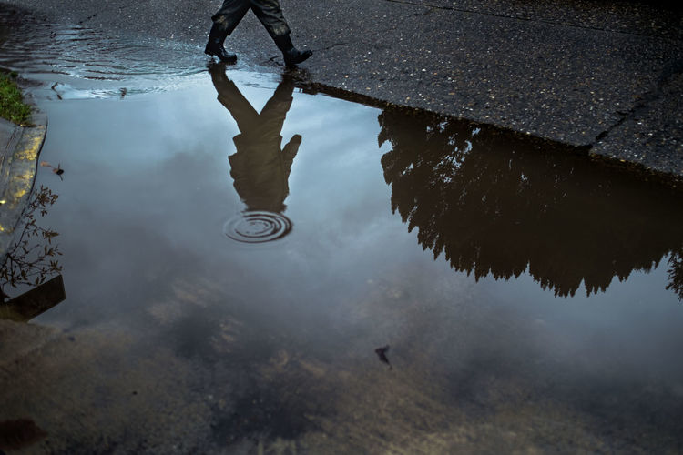 Day Fine Art Photography Fujifilm Fujifilm Xpro1 Fujifilm_xseries Fujinon High Angle View One Person Outdoors Puddle Rainy Season Real People Reflection Silhouette Silhouettes Streetphoto_bw Streetphotographer Streetphotography Valdivia Water Wet Xpro1