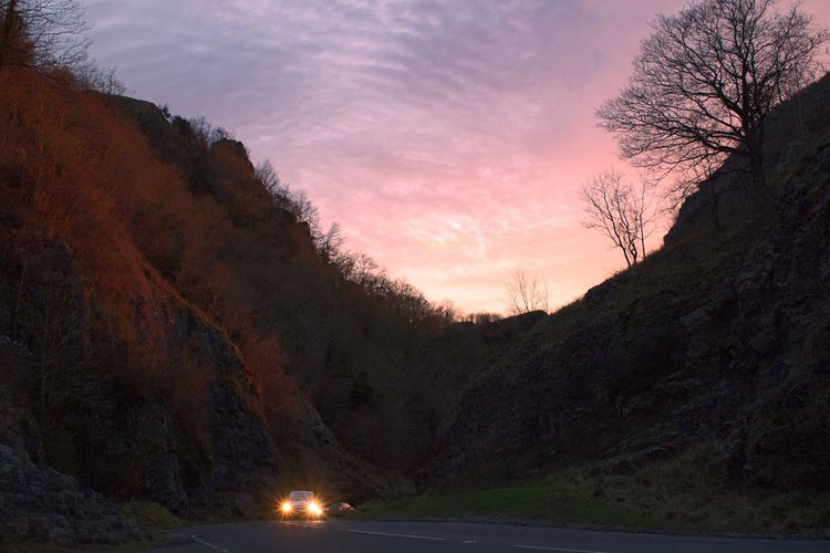 Scenic view of cheddar gorge against sky during sunset