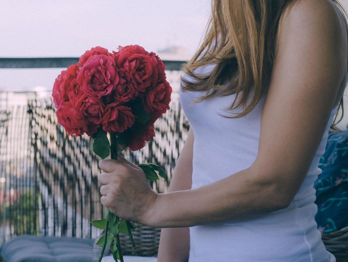 Adult Beauty In Nature Bouquet Flower Flower Arrangement Flower Head Flowering Plant Fragility Freshness Hairstyle Holding Leisure Activity Lifestyles Midsection Nature One Person Outdoors Plant Real People Rosé Rose - Flower Vulnerability  Women