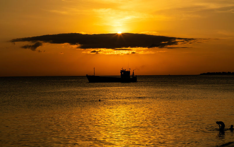 Sunset over the sea at Zanzibar Beauty In Nature Cloud - Sky Horizon Over Water Nature Orange Color Outdoors Reflection Scenics - Nature Sea Silhouette Sky Sun Sunset Tranquil Scene Tranquility Water