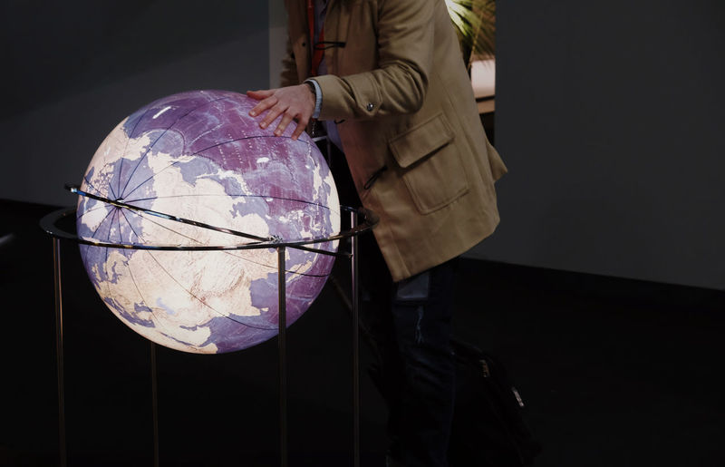 Sphere Indoors  Holding Midsection Reflection Dark Glass - Material Transparent Lifestyles Shape Design Standing Unrecognizable Person Capture Tomorrow Earth World Communication Moments Of Happiness 17.62°