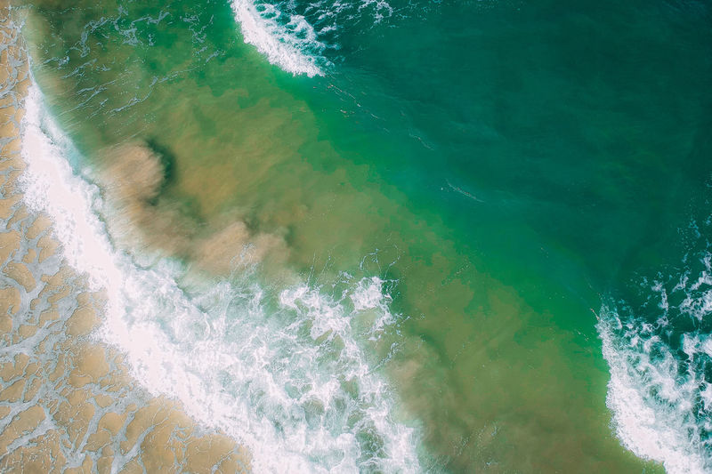 Water Sea Wave Sport Motion Surfing Aquatic Sport Nature Beauty In Nature Beach Power Day Land Power In Nature Outdoors High Angle View Breaking Backgrounds Turquoise Colored