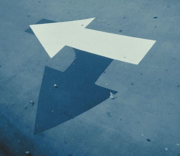 Arrow symbol on road
