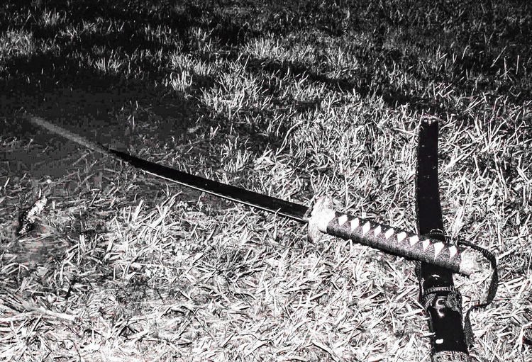 my sword Adobe Adobe Photoshop Sword Katana Swords Creative Photography CreativePhotographer Canonphotography Blackandwhite Black And White Blades Water Puddleography Day No People Outdoors Full Frame Close-up Grass Nature High Angle View