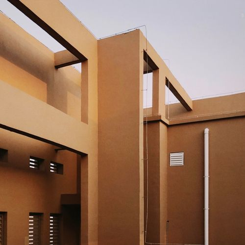IPhone7Plus NOMO 男仔很忙 Architecture Built Structure Building Building Exterior No People Modern Wall - Building Feature House Low Angle View Day Residential District Brown Outdoors Nature Clear Sky Sky Window Entrance Text Ceiling