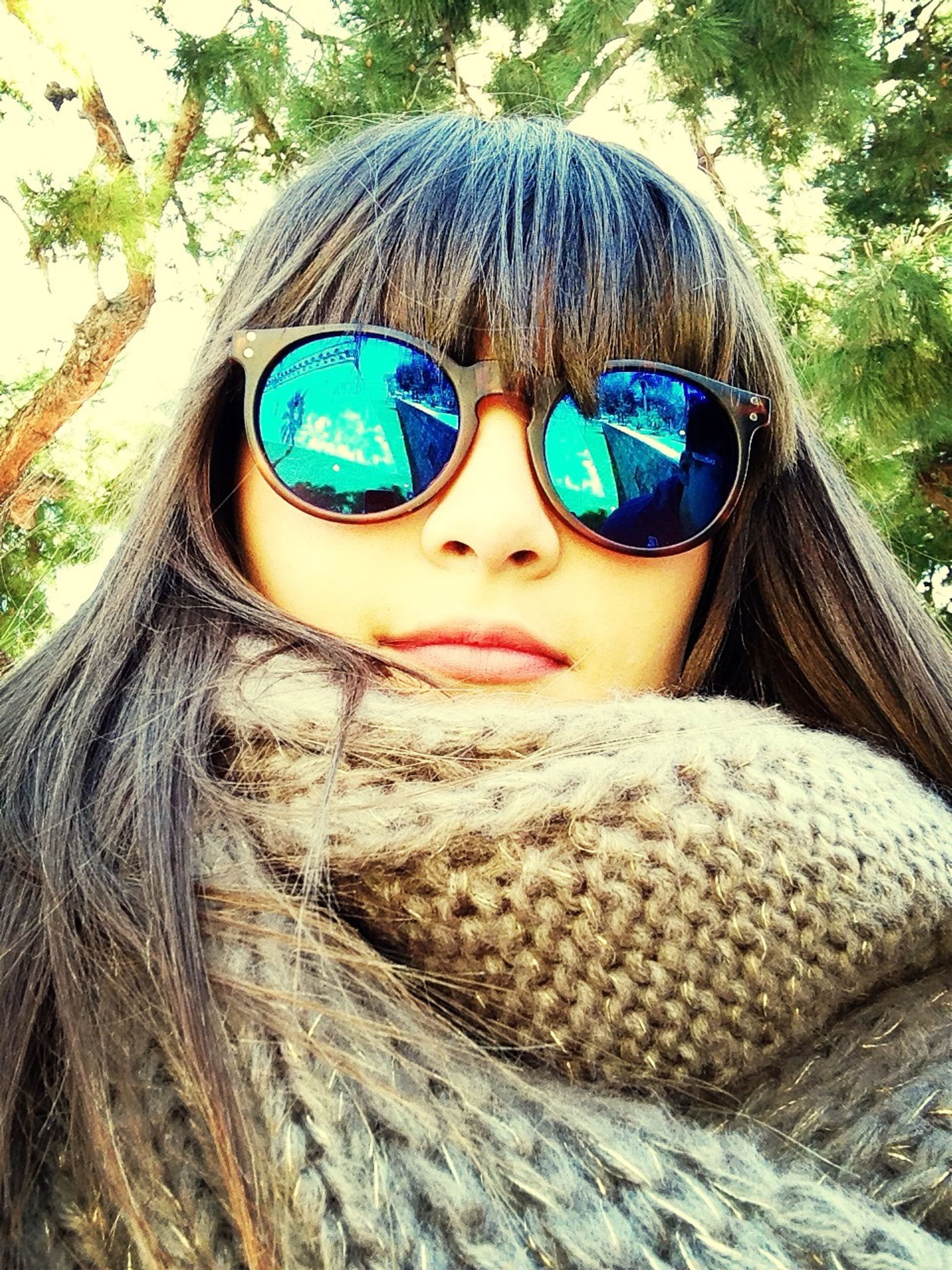 close-up, leisure activity, lifestyles, looking at camera, portrait, headshot, childhood, tree, front view, human face, sunglasses, person, day, circle, long hair, outdoors, focus on foreground, nature