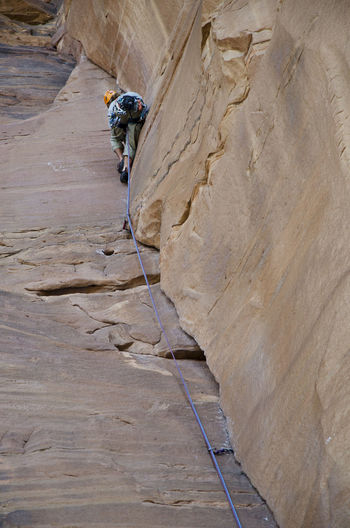 Low angle view of person rock climbing