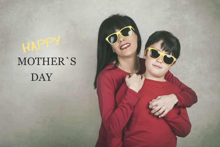 Women Child Portrait Emotion Son Mom Mother Mother's Day Love Family Hugging Fun Funny Happy Happiness Motherhood Lifestyle Smile Complicity Concept Sunglasses Party Expression Celebration Smiling