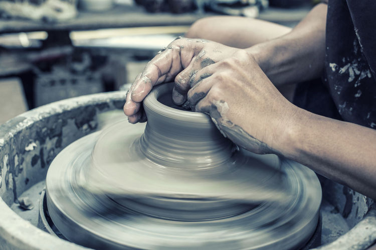 High angle view of woman working on pottery wheel