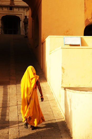 Rear View Of Woman Walking On Pavement At Amber Fort