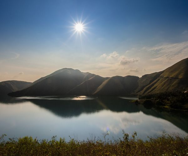 Lake Toba, danau toba, medan, Sumatera Utara Mountain Sky Beauty In Nature Tranquility Water Scenics - Nature Tranquil Scene Lake Reflection Sunlight Sunbeam Nature No People Sun Idyllic Lens Flare Mountain Range Non-urban Scene Day Bright