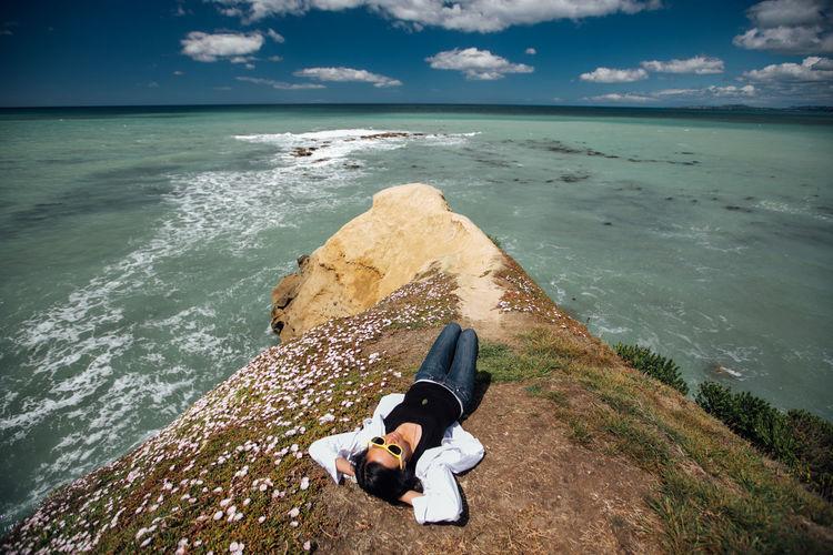 Carefree woman lying at beach