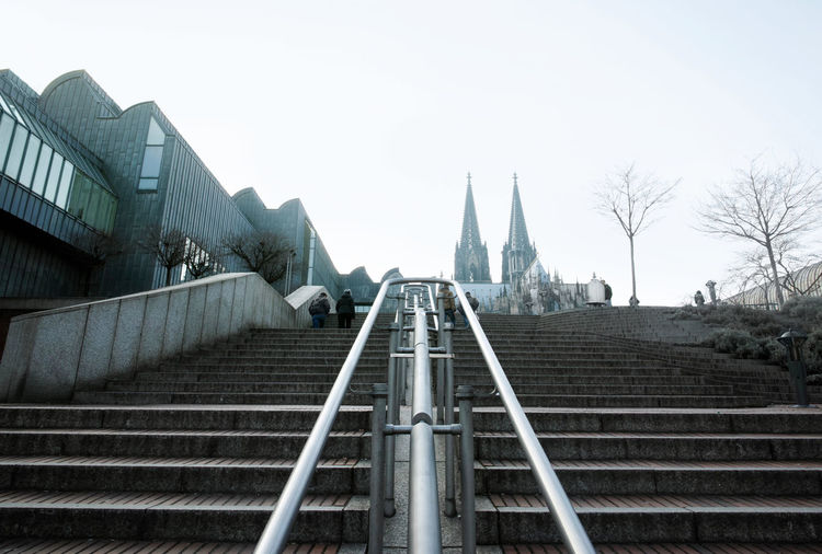 Low Angle View Of Museum Ludwig And Cologne Cathedral Against Sky