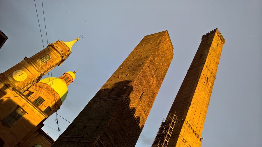 Ancient Ancient Civilization Architecture Bologna Building Exterior Built Structure Clear Sky Day History Low Angle View No People Old Ruin Outdoors Sculpture Sky Statue The Architect - 2017 EyeEm Awards Travel Destinations Two Towers Due Torri EyeEmNewHere EyeEmNewHere