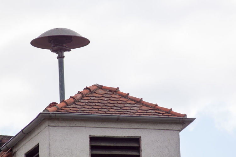 On German roofs - a siren on a building roof Alarm Alert Architecture Building Exterior Built Structure Danger Emergency Fire Hooter House No People Noise Protection Roof Rooftop Safety Siren