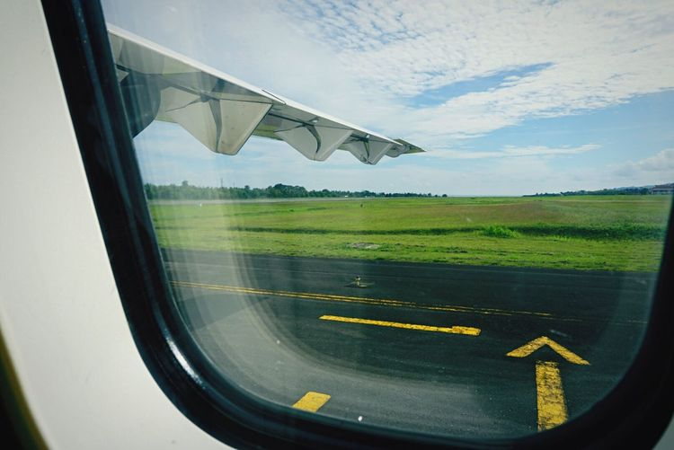 Airport Runway Airport Arrow Sign Airportphotography Window Window View Transportation Window Frame Window Reflections View From The Window... View From Inside Airplane Wings Plane Wing Traveling Home For The Holidays Miles Away Long Goodbye Let's Go. Together.