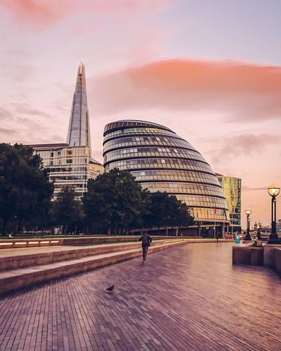 Architecture Built Structure Building Exterior Sky Modern City Real People Outdoors Skyscraper London Sunrise Urbanphotography City Urban One Person Pink
