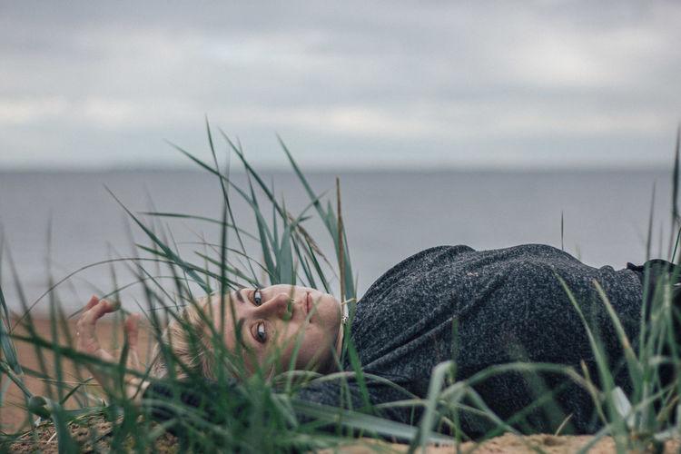 Portrait of man lying in grass