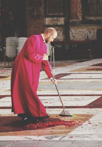 Priest Cleaning