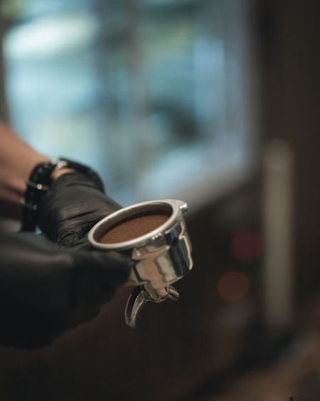Coffee Brewing and Coffee Making Ijas Muhammed Photography Hand Human Hand Human Body Part One Person Close-up Sign Focus On Foreground Social Issues Warning Sign Communication Holding Crime Body Part Weapon Protection Day Safety Violence Outdoors Human Limb Finger Aggression